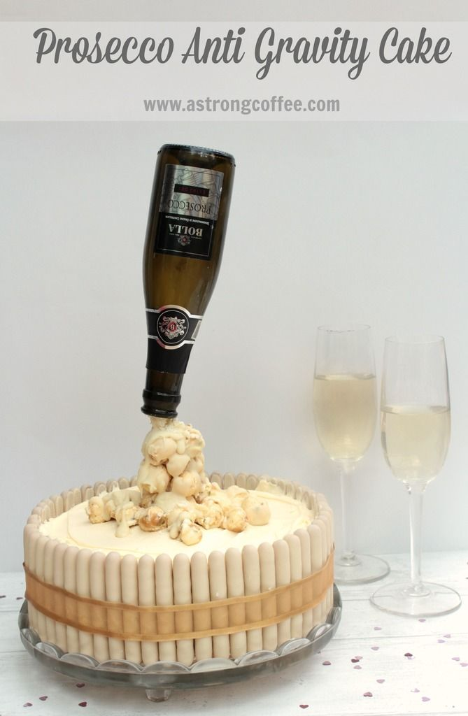 Easy to make Prosecco Anti Gravity cake (sometimes called pouting cake) perfect for a celebration. Uses popcorn and white chocolate to make the bubbles pouring from the bottle. A fun cake for an adult Birthday or New Year Celebration.