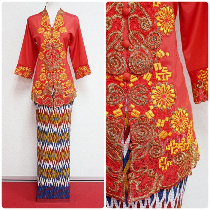 "Kebaya Zariona in red colour is available in M size (best for bust 36""). The tribal motif skirt is stretchable. Purchase this kebaya set online at www.empireofelegance.com.my"