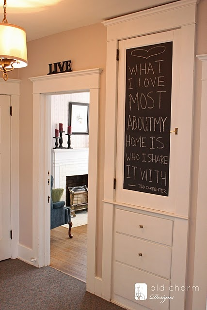 Kitchen door leading to back room.  Attach a sheet metal panel with chalkboard paint to door.  Apply wood trim to face of door to frame steel panel.  Magnetic chalkboard for the boys...complete with large German Shepherd eraser.
