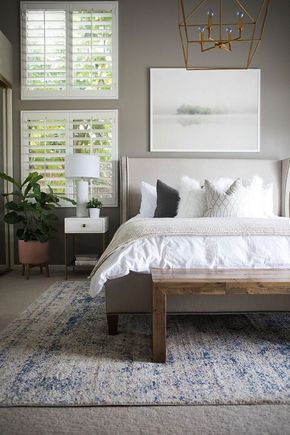 BECKI OWENS--Kailee Wright Master Bedroom Reveal. A fresh bedroom update with Benjamin Moore Greystone, fresh white linens, and gold accents.