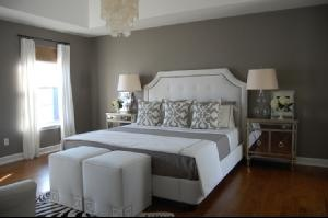 I love this bedroom. Simple, but cozy! I want those pillows.