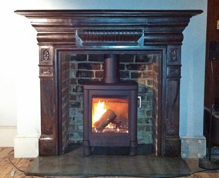 Original Victorian cast iron surround with slate hearth, renovated brick chamber and Contura 51 L wood stove, fitted in Queens Park, London NW 6 by Scarlett @ Design a fireplace 2011