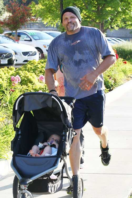 Chuck Liddell keeps in shape with his baby. Cute!