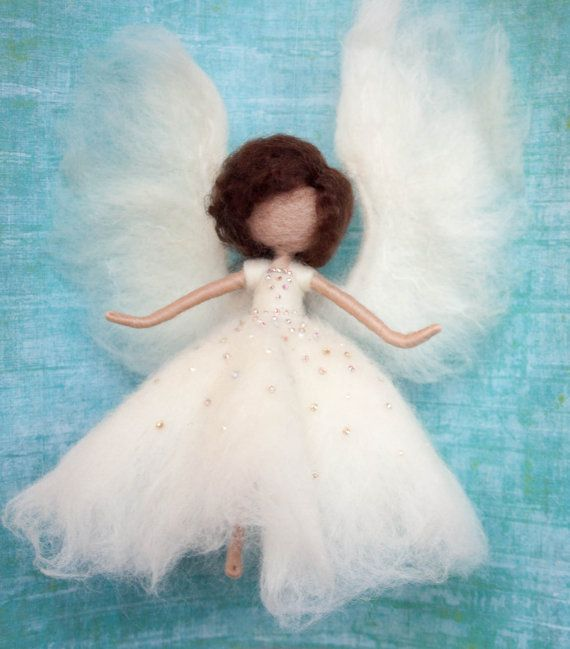 ***READY TO SHIP***  A cute little needle felted Waldorf inspired angel, wearing a white dress, with big fluffy wings.  Made from ethically