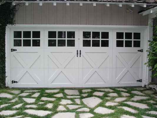 Painted, wood carriage house doors.  Look at that driveway!  A perfect fit. | Yelp