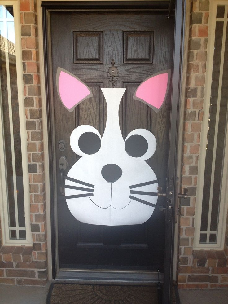 I decorated my front door for my granddaughters 6th birthday party. She wanted a kitty party, so I created a cat. and like OMG! get some yourself some pawtastic adorable cat shirts, cat socks, and other cat apparel by tapping the pin!