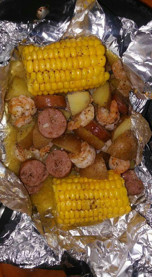 Shrimp, Sausage, Potatoes, and Corn. Cut potato of your choice (red) make sure they are bite sized to cook. Peel and devein shrimp, cut up sausage (smoked), place sheet of aluminum foil and 2 halves of frozen corn, hand full of shrimp, sausage, and potato. Add salt and pepper creole seasoning, a pat of drizzle and olive oil. Place a second sheet of aluminum foil. Make a pouch and bake on sheet pan for 35-40 minutes at 400°. If potatoes are not done they were not small enough.