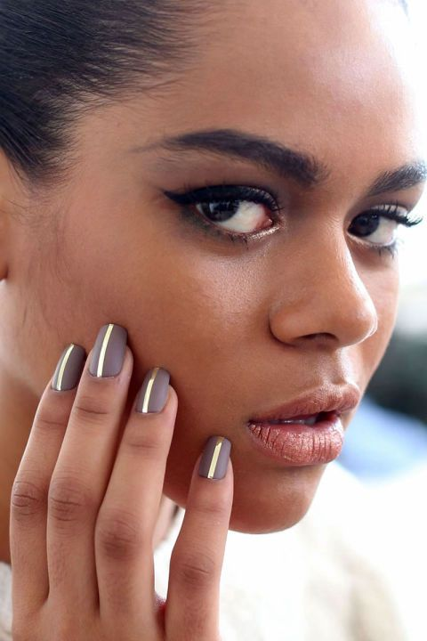 Manicurist Junko Watanabe gave the models a matte taupe nail, then contrasted it with a single strip of gold foil down the center.