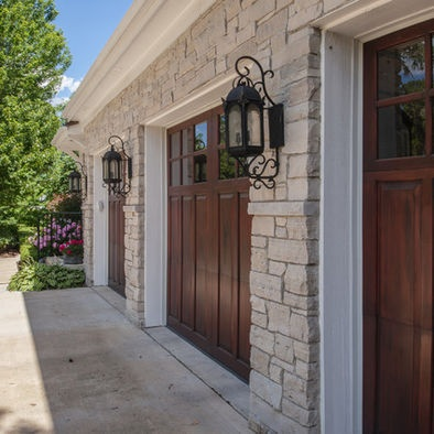 Traditional Garage With Natural Stone Exterior, Wrought Iron Wall Sconce,  Lantern Style Sconce, Carriage House Garage Doors