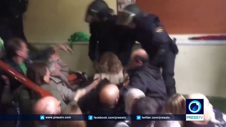 Barcelona police beat, drag voters out of polling station