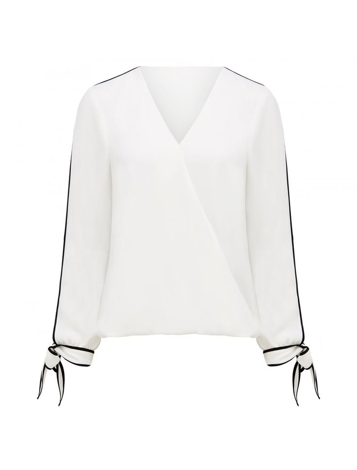 Discover a new wardrobe favourite and channel chic sophistication with our Mariah Contrast Bind Wrap Tie Top, sure to see you transition effortlessly from day to night.