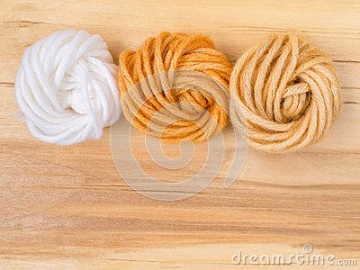 Wool bun swatches colored by henna and henna and amalaki mix and control white sample