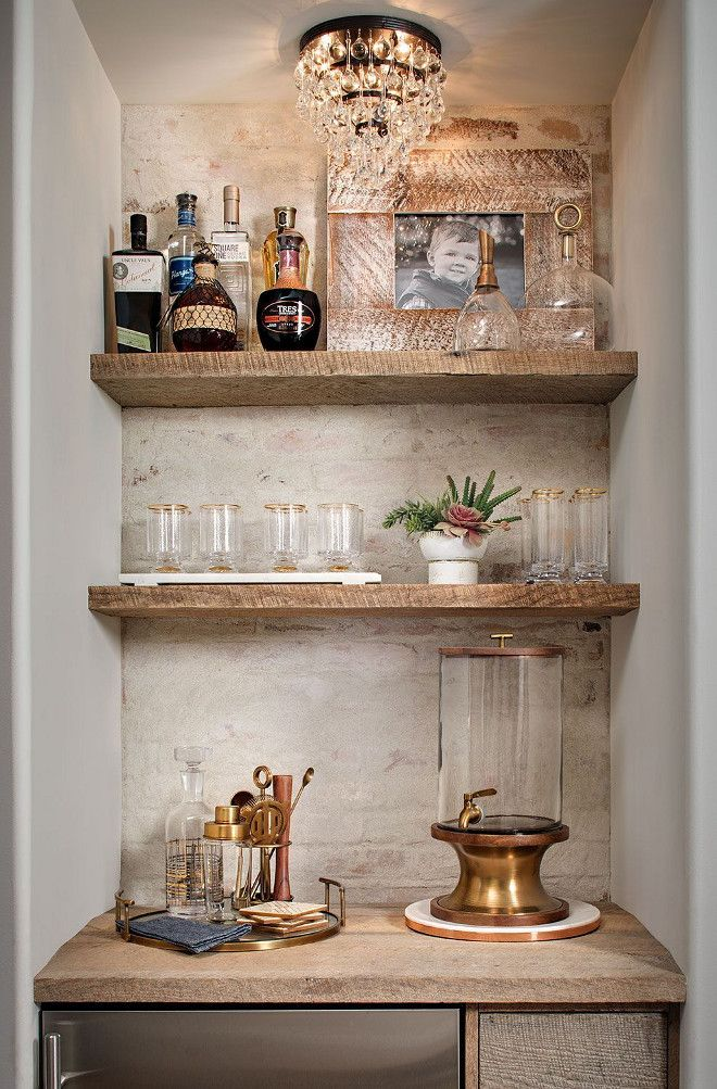 Farmhouse wet bar with white brick wall and reclaimed wood shelves. The accent ​brick wall features a whitewash over the brick and it's done with grout washing not paint.