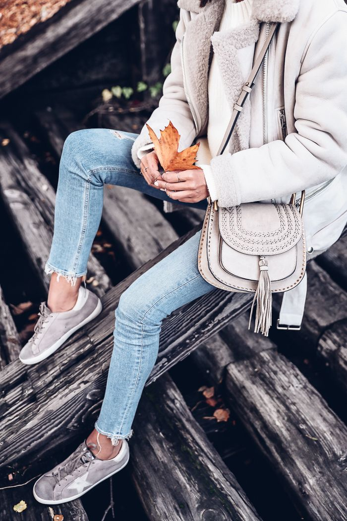 ACNE STUDIOS More She Sue sherling jacket, 3.1 PHILLIP LIM Saddle Crew neck pullover, GOLDEN GOOSE Superstar sneakers, 7 FOR ALL MANKIND jeans, CHLOÉ Hudson bag, DITA sunglasses