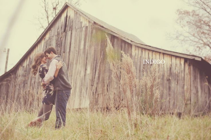 Super fantastic engagement photo - awesome pose next to old wooden barn
