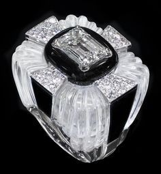 VERY FINE DAVID WEBB PLATINUM, DIAMOND AND ROCK CRYSTAL RING Signed Webb & Plat 18K. Centered by an emerald cut diamond weighing approximately 3.25 cts. Pave set with round cut diamonds weighing approximately 1.00ct. Enhanced with black enamel.
