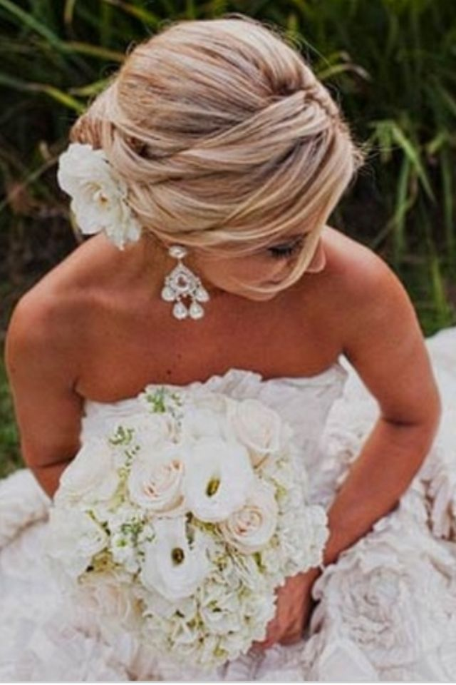 Romantic hair, flowers, gown