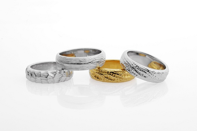 Selection of textured wedding bands in 18ct. Yellow and white gold, Trove collection. Chris Hawkins Jewellery.