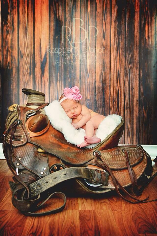 Cowgirl.newborn.saddle