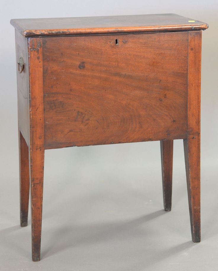 Mahogany cellarette having lift top chest on square tapered legs, circa 1790-1810 (no partitions inside).  ht. 24 in.; case wd. 18 1/2 in.; dp. 10 3/4 in. ~ Realized Price $3,120.00