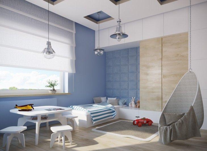 Aranżacja wnętrza pokoju dziecięcego w niebieskich tonacjach. Za łóżkiem znajduje się tapicerowane wezgłowie. Sufit podwieszany ma geometryczną formę i wypuszczone są z niego chromowane lampy.