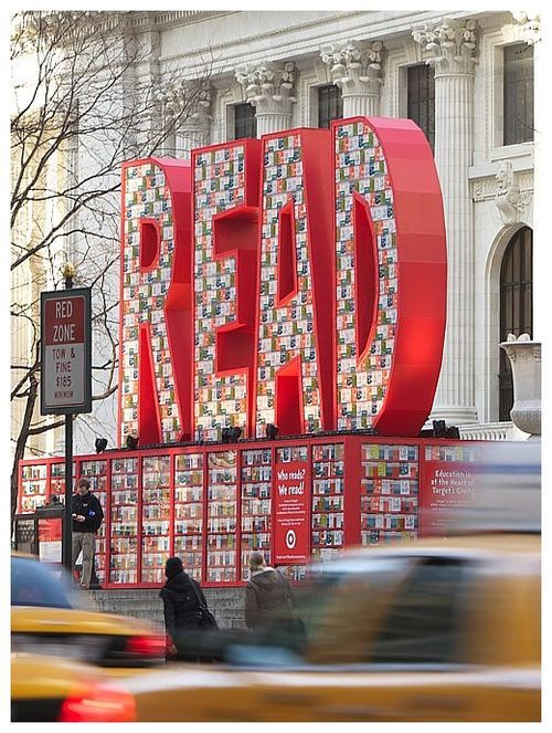 "New York Public Library: 26 foot tall ""Read"" installation. It was made from 25,000 Dr. Seuss books that were donated to schools and libraries when the installation came down."