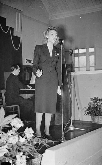 Vera Lynn sings at a munitions factory, Britain 1941 [Public domain, Imperial War Museum, wiki]