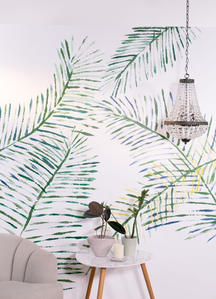 Would you believe this DIY palm leaf print wall mural was painted with pool noodles?!