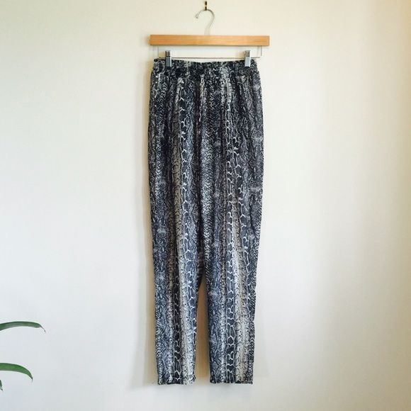 Tobi Snake Print Pant Tobi Snake Print lounge pant. Super comfy with tie front and zip pockets. White lined under the snake print. Length '30 and size small. Tobi Pants
