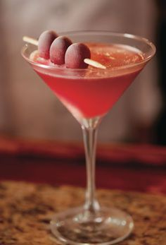 Bonefish Grill Pomegranate Martini: 1.5 oz Fris Vodka, .75 oz each of Monin Pomegranate & Mango Syrups. Place all ingredients into a shaker tin filled with ice. Cover and shake vigorously 20 times. Strain into a chilled martini glass. Garnish with 3 skewered grapes placed on edge of glass.