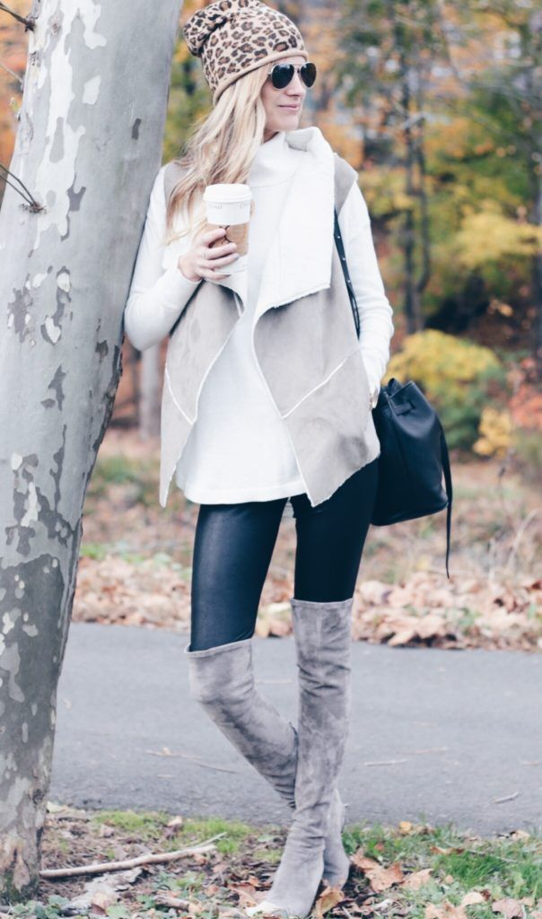 fall outfit: shearling vest with leather leggings and suede over the knee boots and leopard beanie