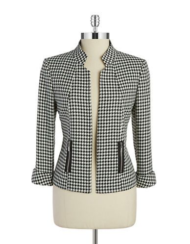 classic without looking stuffy . . . A classic houndstooth pattern in a sophisticated silhouette with zip pockets.