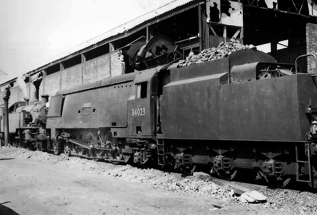 """This picture shows now preserved Bulleid 'WC' 4-6-2 no.34023 """"Blackmore Vale"""" (at the Bluebell Railway) at Eastleigh MPD coaling stage in May 1966. She survived for over another 12 months, succumbing in July 1967. Also in the photo is an unknown ex LMS Ivatt 2MT 2-6-2T.  Remember that pictures look better if viewed using Light Box (L key)."""
