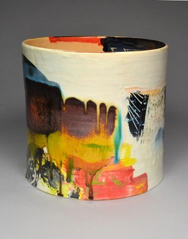 Lauren Mabry ceramic cylinder abstract runny glaze.   small white plastic trash can decorated?