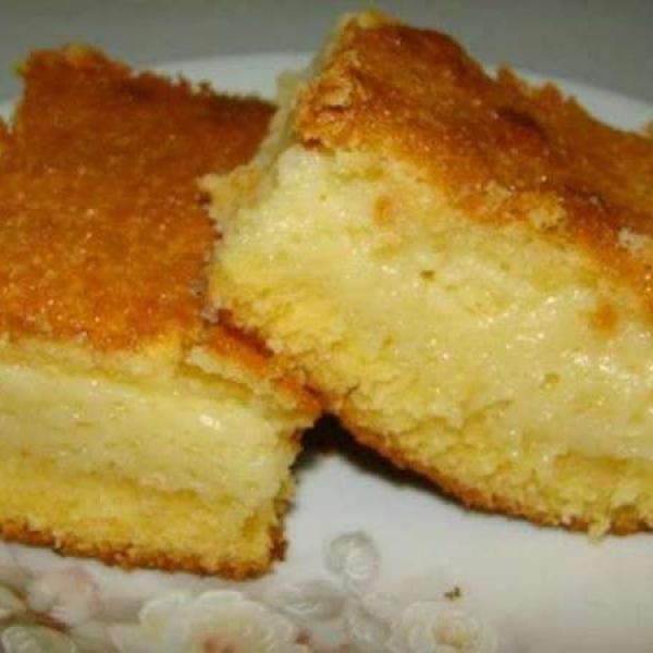 Receita de Bolo de Milho Cremoso - 2 copos (requeijão) de leite , 2 copos (requeijão) de açúcar refinado , 3 colheres (sopa) de farinha de trigo , 3 ovos gr...