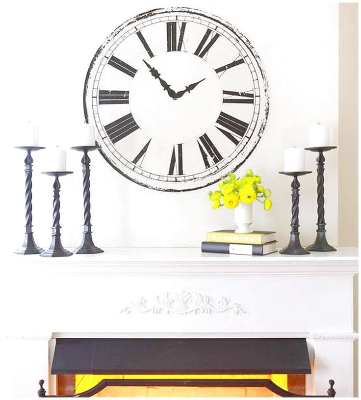 GET AN ATTRACTIVE LOOK WITH FIREPLACE MANTEL WITH ORNATE FIREPLACE WHICH HAS A BLACK CANDLE