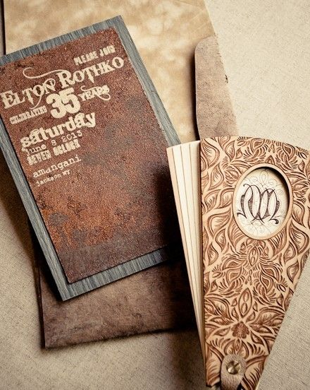 Brown invitation - To really wow your guests opt for an invite that combines wood and distressed leather.