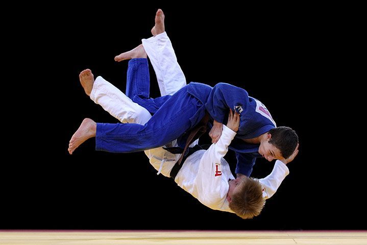 Great Britain's Austin Jones and Tom Johnson grapple during a training session ahead of the London 2012 Olympic Judo test event at the ExCelPhotograph: Clive Rose/Getty Images