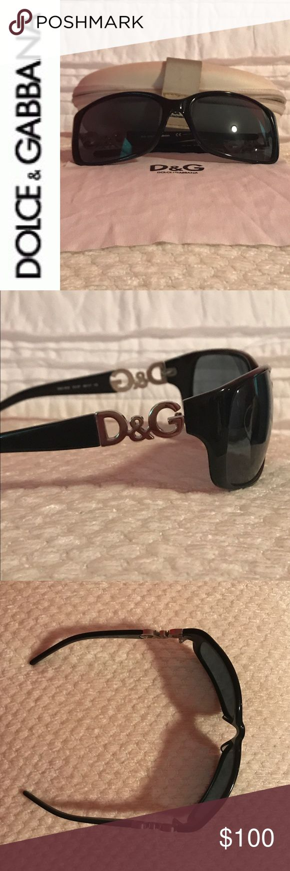 Fabulous Dolce & Gabbana Sunglasses Dolce and Gabbana Sunglasses Black Frames and Lenses.  This curve hugging silhouette with distinct silver DG logo melds contemporary elegance with high fashion accessories.  Excellent Used Condition, cleaning cloth and case included. Dolce & Gabbana Accessories Sunglasses