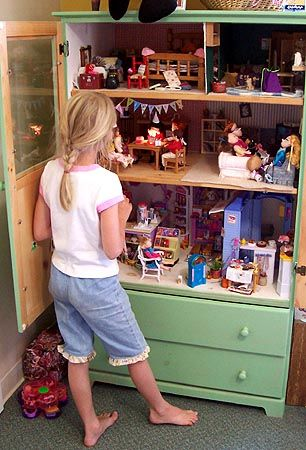 Paint an amour a bright color and use the upper portion as a doll house and a place to stash all the dolls and use the bottom drawers for all the clothes and accessories.  So clever!!