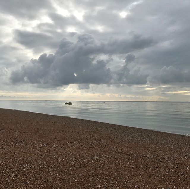 Why can't I live by the sea? Take me back. . . . . #hastings #seafront #pebblebeach #loneboat #quietbeach #cloudysky #cloudybeach #fishingboat #nofilter #montereylocals #pebblebeachlocals - posted by Llia Apostolou https://www.instagram.com/llia - See more of Pebble Beach at http://pebblebeachlocals.com/