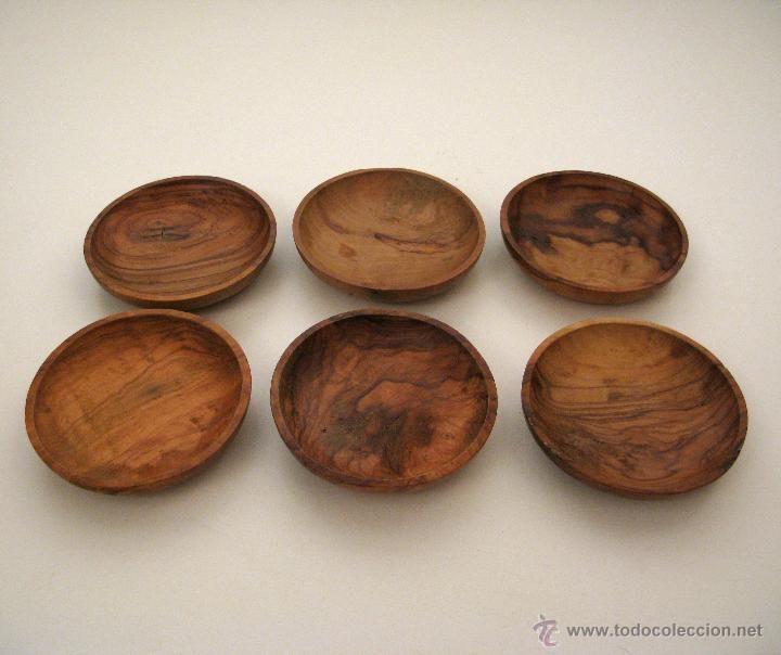 Antiguo juego de platos en madera de olivo para aperitivo.