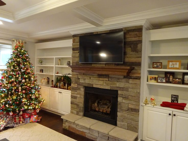 Stone & rock fireplace TV installation in Greenville, SC. This was a TV install we finished up before Christmas. if you need help with your TV installation, give us a call at (864) 881-1675.
