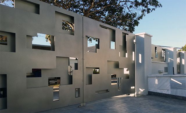 Axolotl continue to be at the forefront of door design and gates and garage doors are no exception. The first example below, is a series of zinc gates with a double-screen design, that provides structural integrity and security whilst maintaining a contemporary aesthetic.
