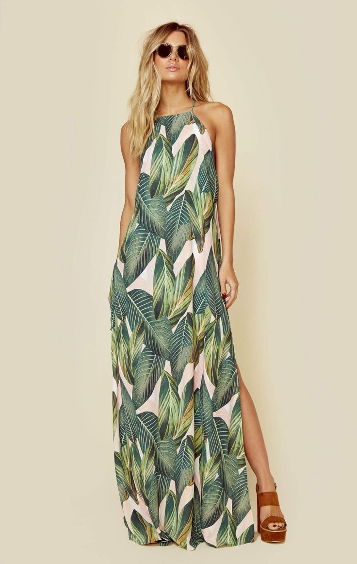 "Channel your bohemian beauty in Show Me Your Mumu's Bronte Maxi Dress. Featuring a palm print throughout, side slits, racerback design, and mini slip underneath.   Made in USADry Clean Only100% PolyFit Guide:Model is 5ft 7 inches; Bust: 34"", Waist: 25"", Hips: 35""Model is wearing a size XSRelaxed FitShoes Featured Not Available For Purchase"