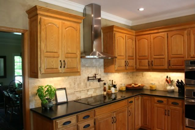 Granite with oak what color light or dark kitchens for Dark oak kitchen cabinets