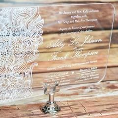 "The ""Botanic Garden"" is a beautiful acrylic wedding invitation printed in white font on clear acrylic base with an elegant modern floral design.  This ""Elegant Acrylic Wedding Invitation"" is available in various sizes and is also available in a variety of font styles and colours including color for the acrylic base (i.e. clear, white, black) We are located in Melbourne, Australia and can deliver worldwide. Note:  minimum quantities apply with some of our acrylic invitations.  Inquire within."