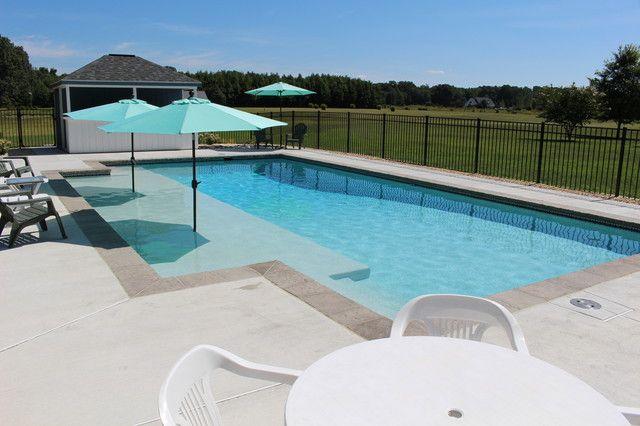 contemporary pool design with sunshelf