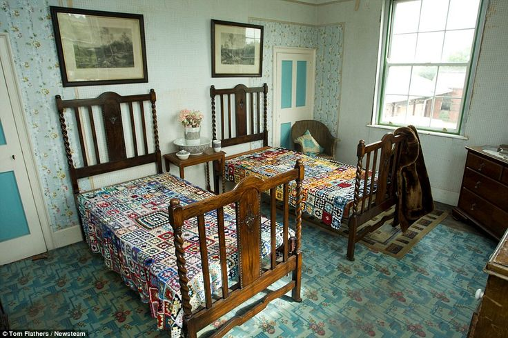 Visitors: One of the guest bedrooms, decorated with crocheted quilts on the solid wooden b...