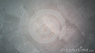 A shot of a grey concrete wall.